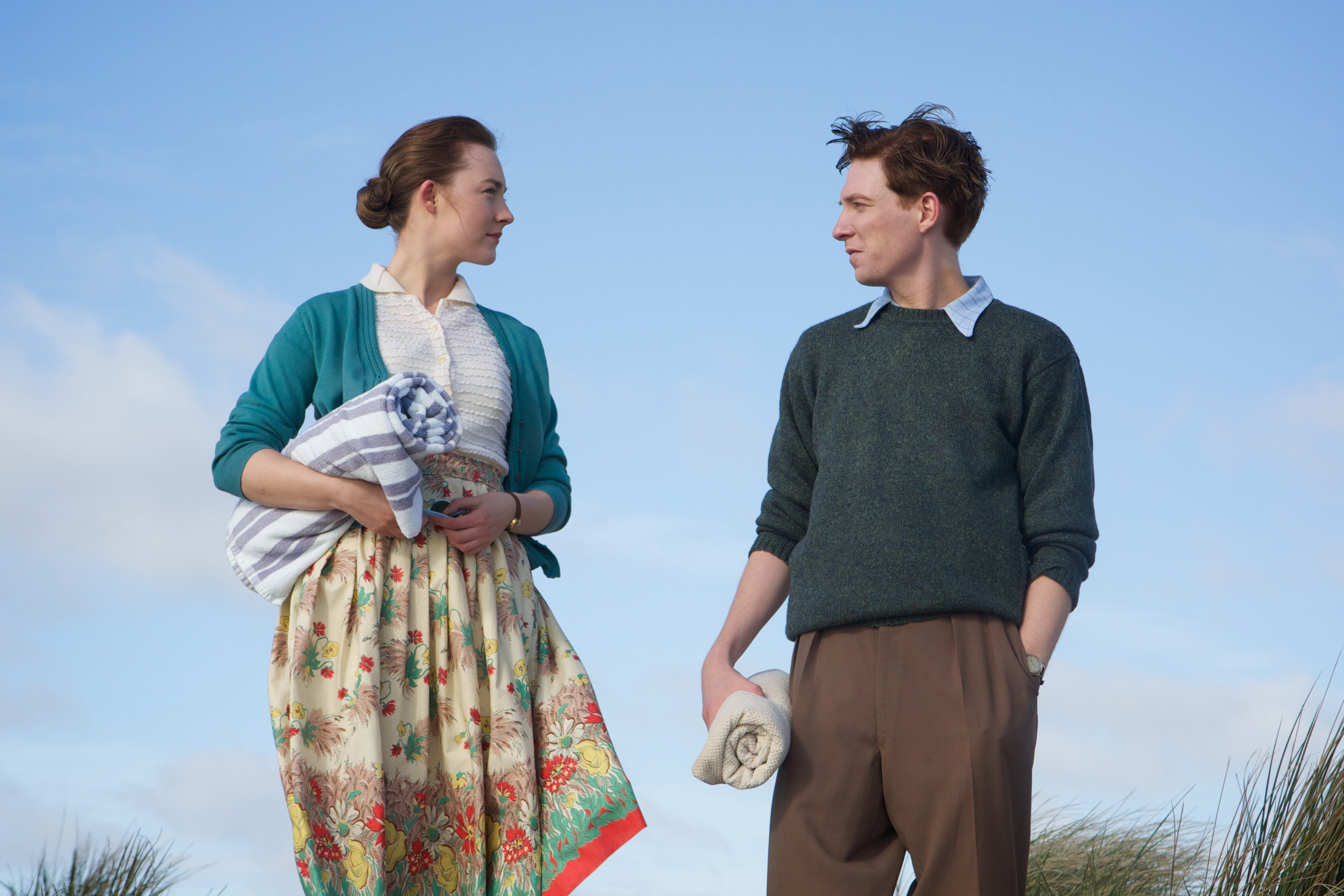 """Saoirse Ronan as """"Eilis"""" and Domhnall Gleeson as """"Jim"""" in BROOKLYN. Photo by Kerry Brown.  © 2015 Twentieth Century Fox Film Corporation All Rights Reserved"""