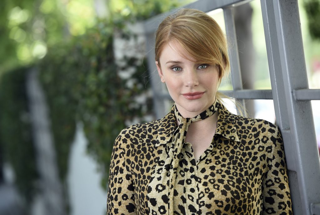 "In this July 15, 2016 photo, actress Bryce Dallas Howard, a cast member in the film ""Pete's Dragon,"" poses for a portrait at the SLS Hotel in Beverly Hills, Calif. (Photo by Chris Pizzello/Invision/AP)"
