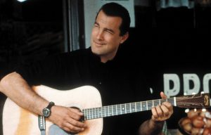 Steven Seagal playing guitar